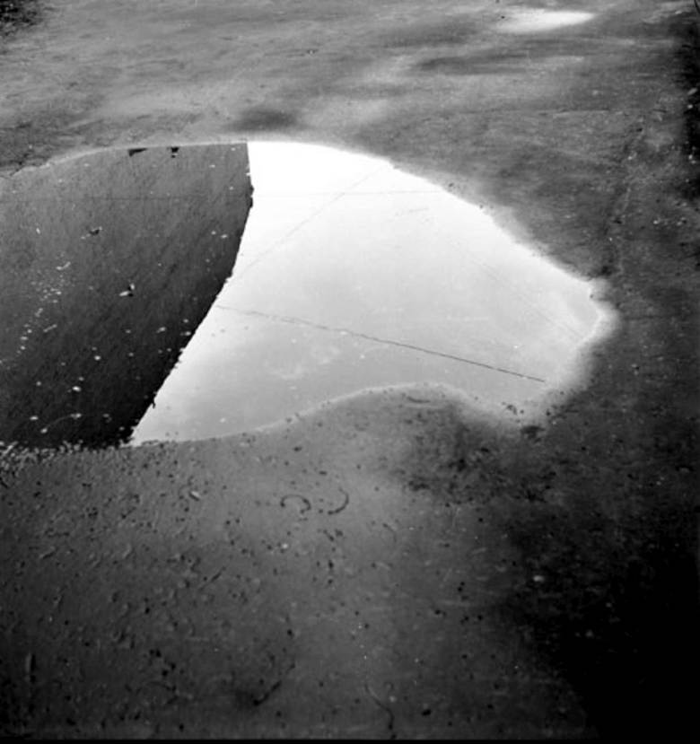 Alexandre Slusarev pothole and clouds Moscow 1977